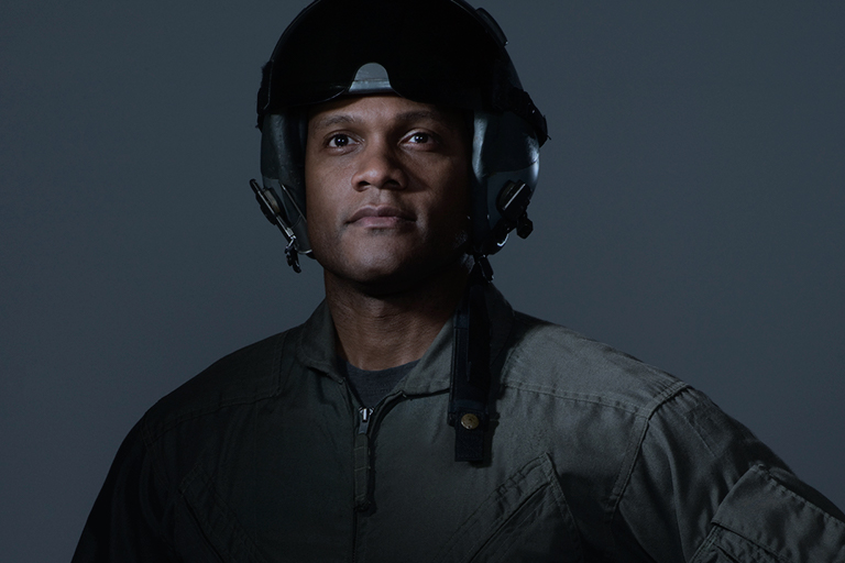 Portrait of a pilot wearing a helmet and jumpsuit